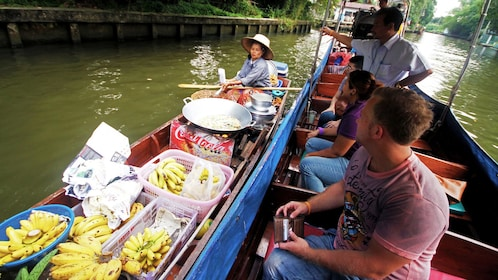 Close up of boat with several bananas on it.