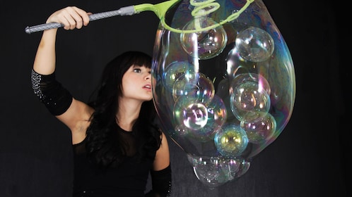 performer in bubble show