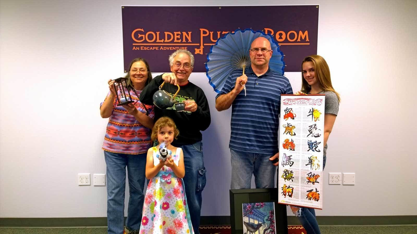 group posing with activity props in Denver