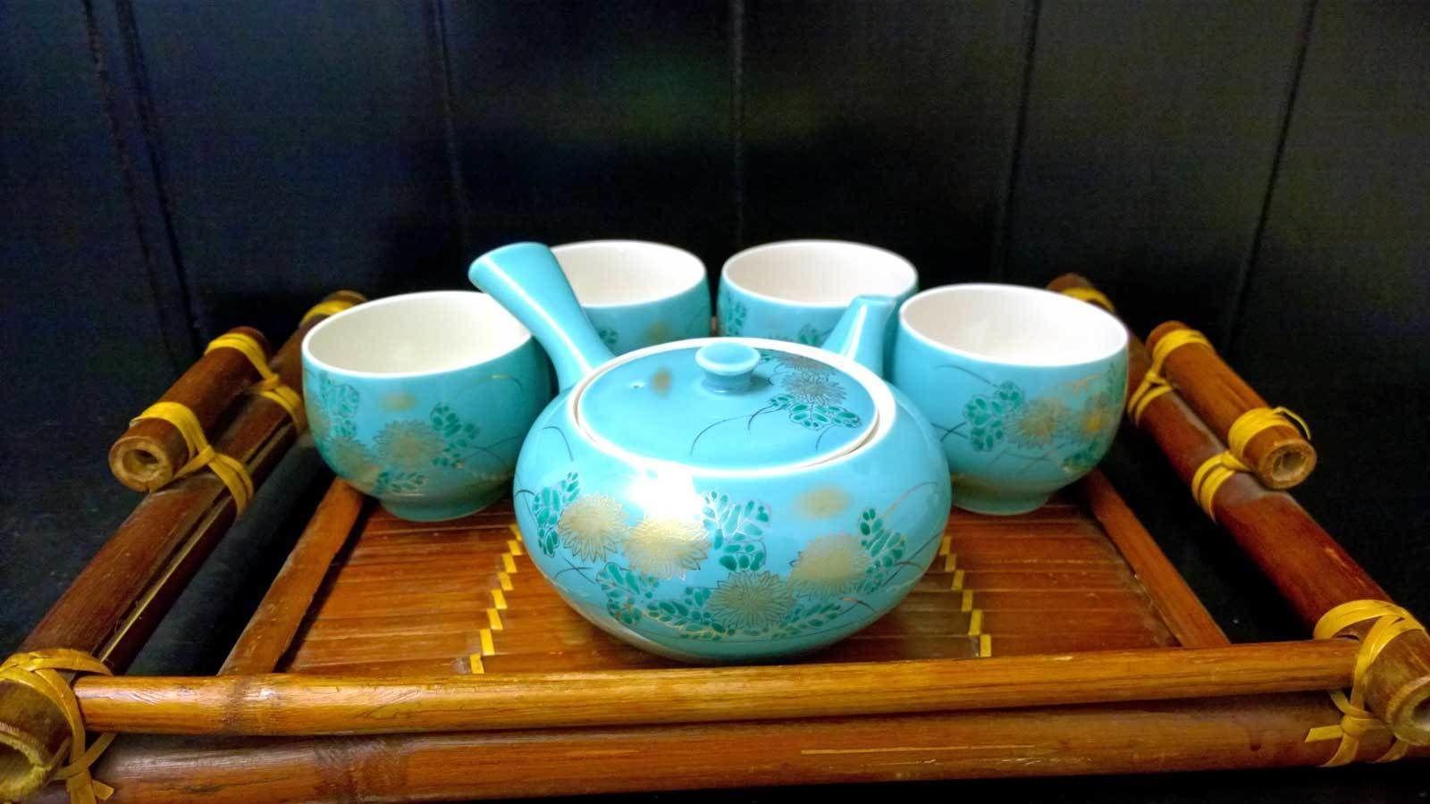 blue ceramic tea pot on a tray in Denver