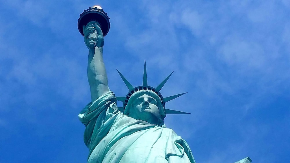 Show item 7 of 7. Upward angle of the Statue of Liberty