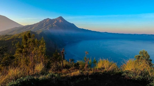 reaching up the mountains during sunrise in Bali
