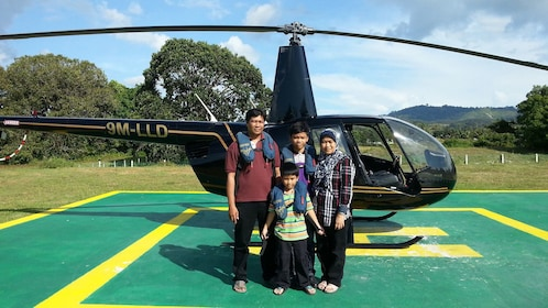 Family in front of a helicopter