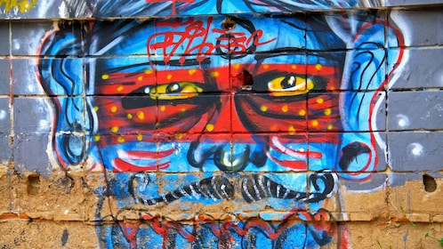 Wall of depicting colorful street art.