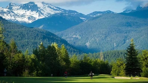 Golf course with mountains in the distance in Whistler
