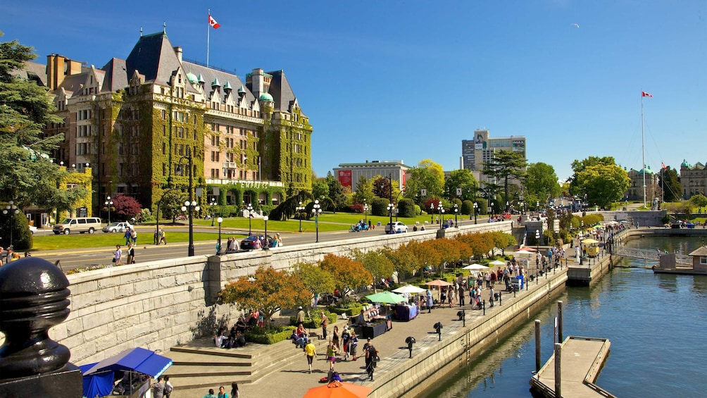 Show item 1 of 5. Empress Hotel and walkway along the water's edge in Victoria