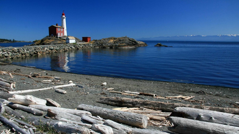 Show item 5 of 5. Beach and lighthouse in Victoria