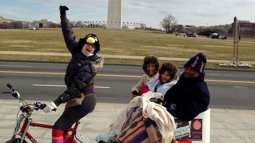 Pedicab with passengers in front of the Washington Monument in Washington DC