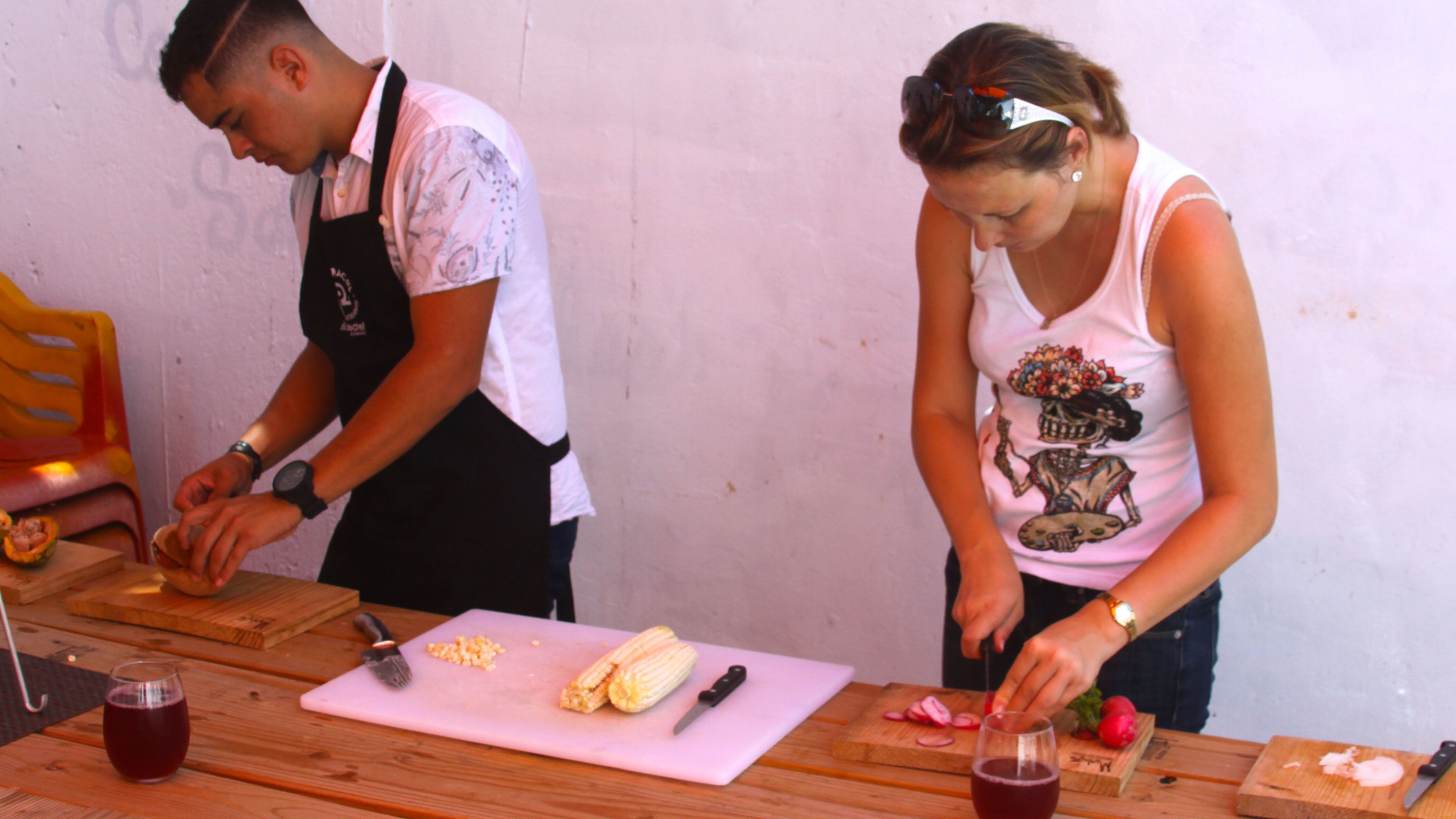 A woman and a chef chopping ingredients