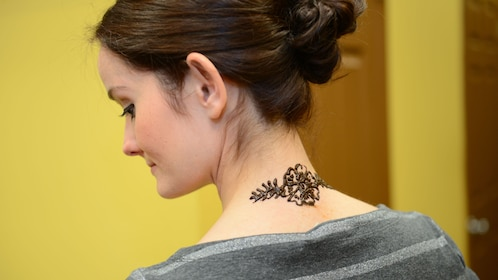 A woman with a Henna tattoo on her neck