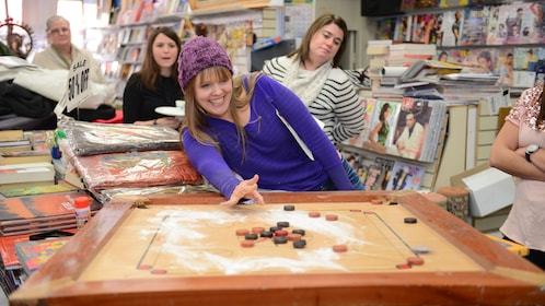 A woman plays a table top game