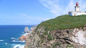 Show item 3 of 5. lighthouse on a cliff in Portugal