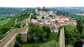 Show item 5 of 5. Castle walls next to town in Portugal