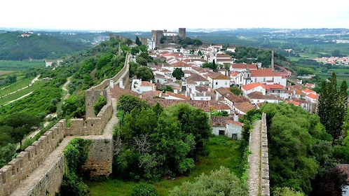 Castle walls next to town in Portugal
