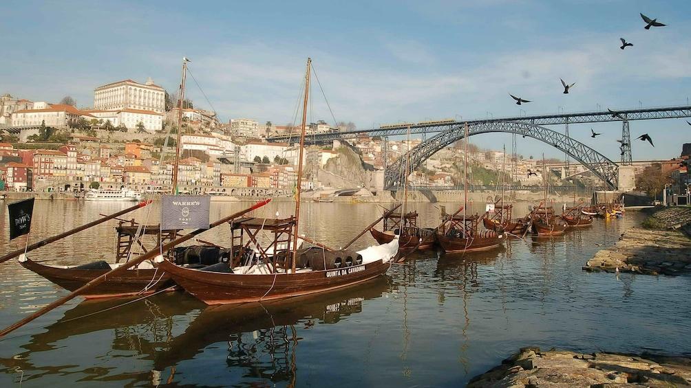 Show item 1 of 8. Small boats in the Oporto Harbor in Portugal