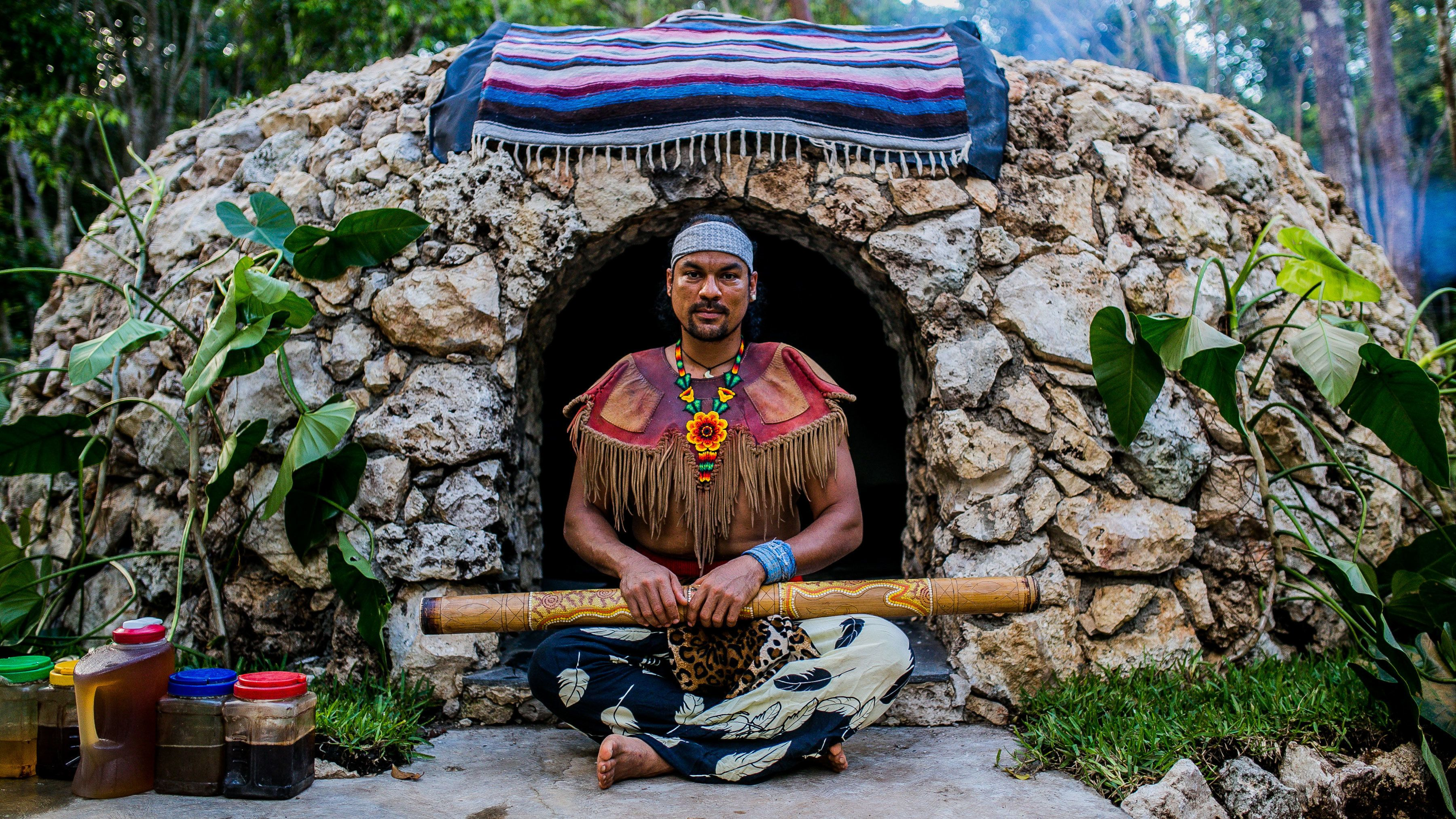 Shaman next to stone hut used for Temazcal Ritual