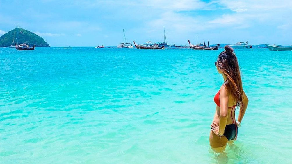 Show item 5 of 5. Young woman enjoying the scenic views on Phuket Coral Island