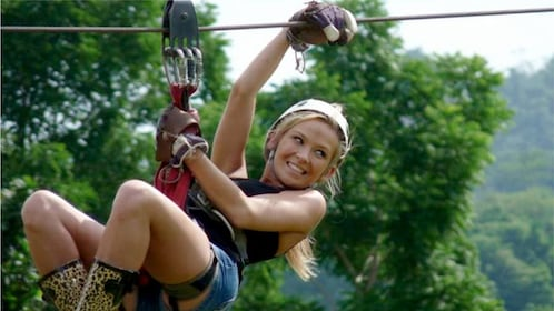 Woman ziplining on the Secret Falls Canopy Adventures tour in Koh Samui, Thailand