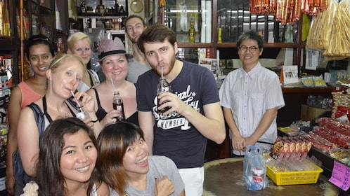 Group enjoying beverages on the Bites and Sites tour in Bangkok