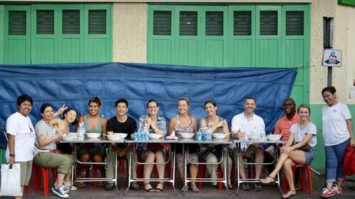 Group enjoying food on the Evening Chinatown Food Crawl in Bangkok, Thailand