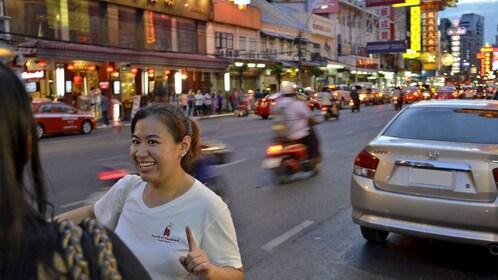 Tour guide at night in Bangkok