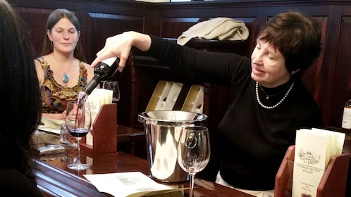 Sommelier pouring wine for vineyard guests in Baltimore