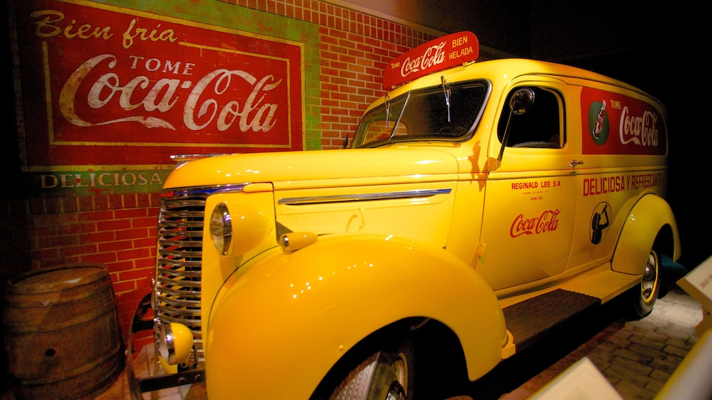 Show item 4 of 7. Vintage car and advertising display at the Wold of Coca-Cola in Atlanta