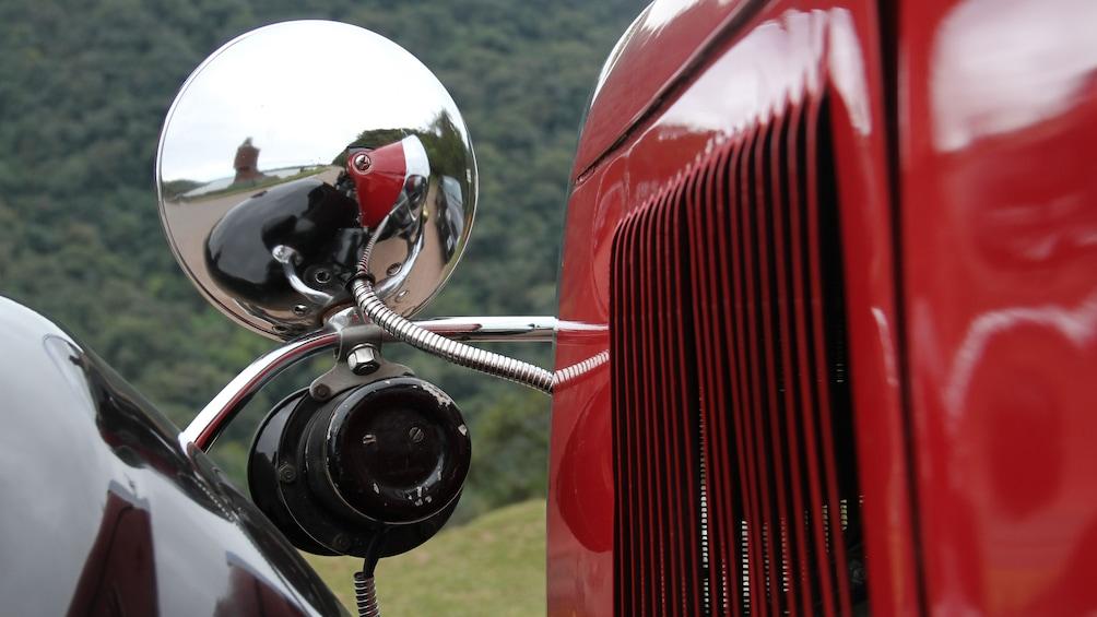 Show item 4 of 5. close up of red antique car