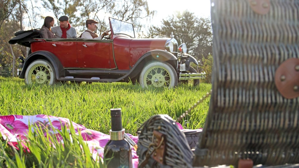 Show item 1 of 5. picnic basket near an antique car in Argentina