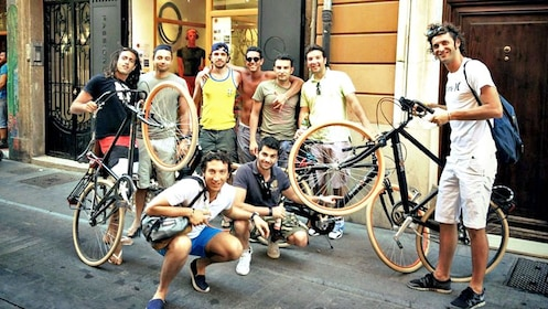 large group posing for photo with bikes in Valencia