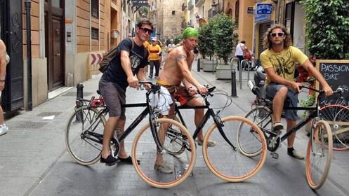 riding bikes on a narrow street inValencia
