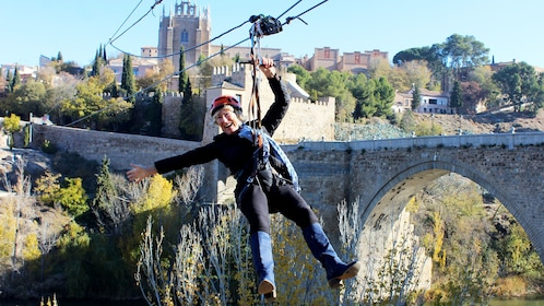 Woman enjoying a Ziplining in Toledo, Spain