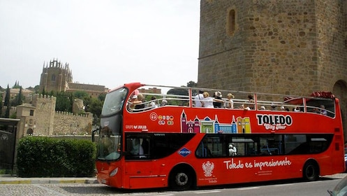 Red double decker tour bus in Toledo, Spain