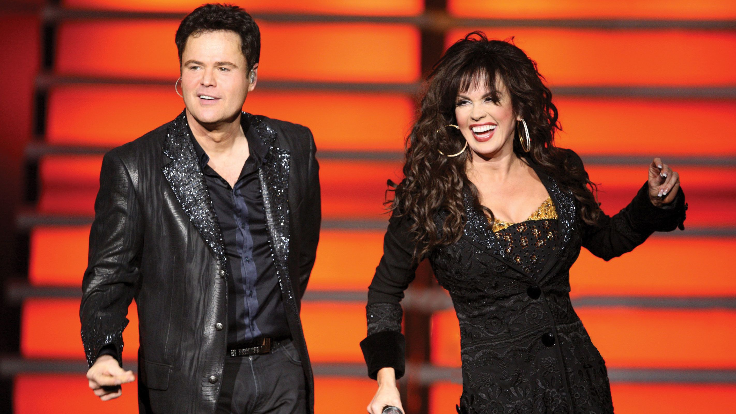 Donnie and Marie singing in a Vegas show