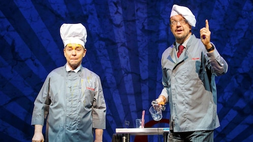 Penn and Teller in chef costumes in Las Vegas