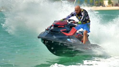 man revving up jet ski in Abu Dhabi