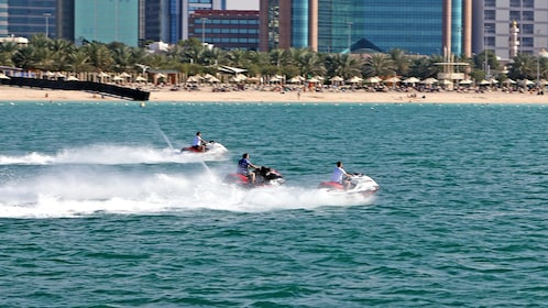 jet skiing along the beach in Abu Dhabi
