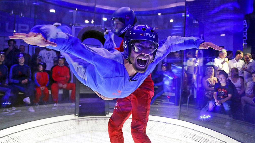 Show item 1 of 6. Man having fun on the Indoor Skydiving Experience in Brasilia, Brazil
