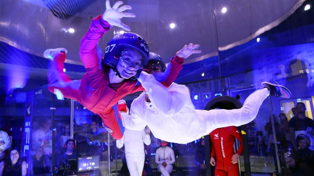 Show item 2 of 6. Guest having a good time on the Indoor Skydiving Experience in Brasilia, Brazil