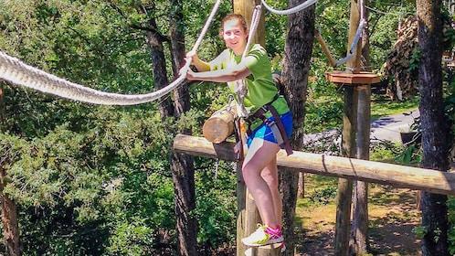 Girl crossing obstacle at Adventureworks in Nashville