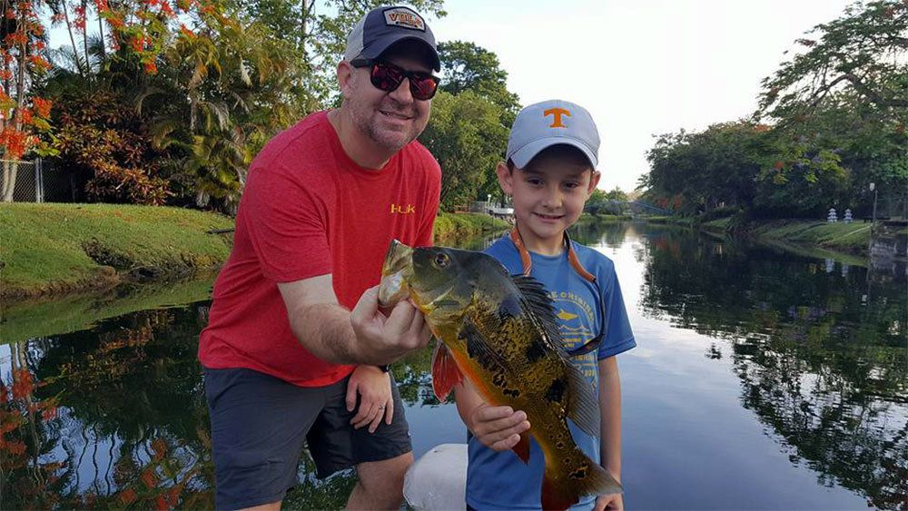 Father and son on the Peacock Bass Fishing Trip in Miami