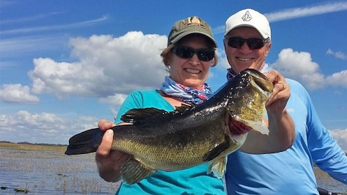 Couple holding freshly caught fish on the Gainesville Bass Fishing Trip in Orlando, FL