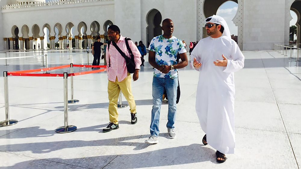 guiding visitors in a mosque in Abu Dhabi