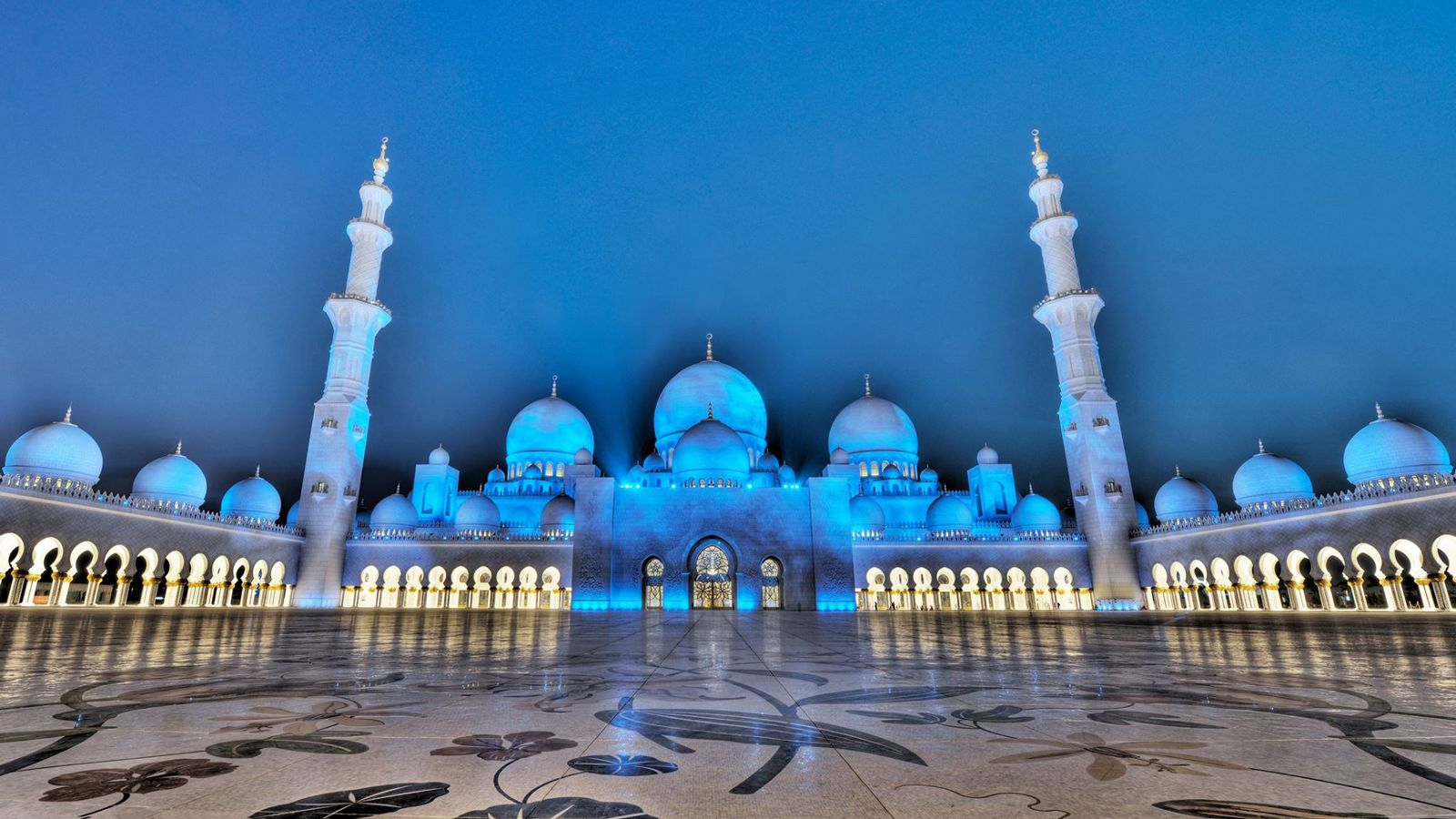 mosque beautifully lit during the evening in Abu Dhabi