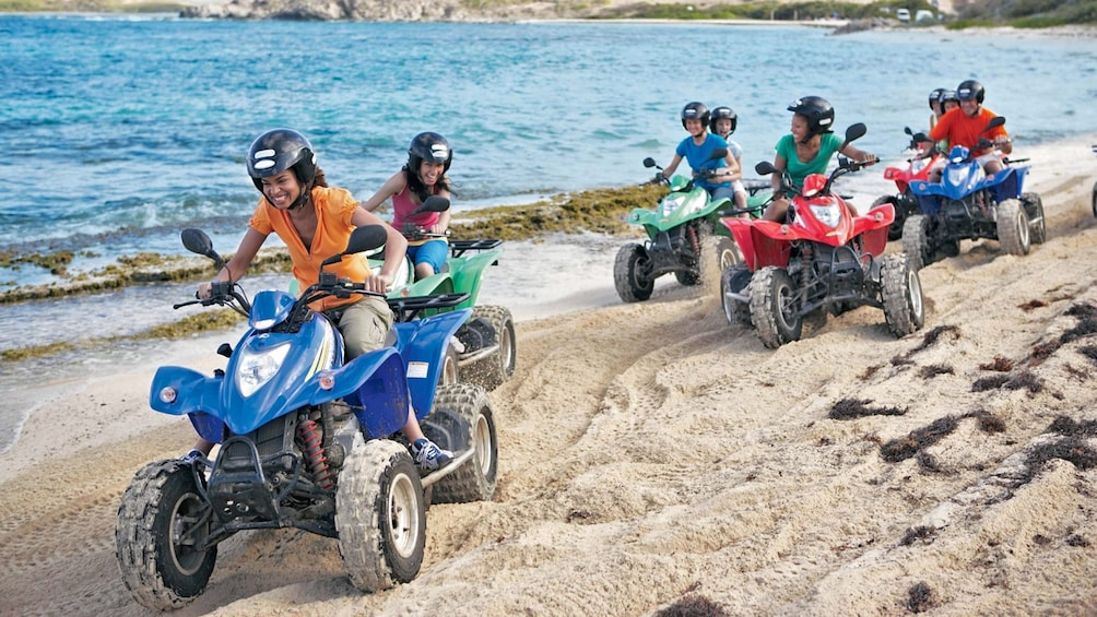 Show item 1 of 5. ATV riders on the beach