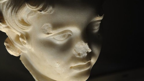 Marble head sculpture of boy missing a nose