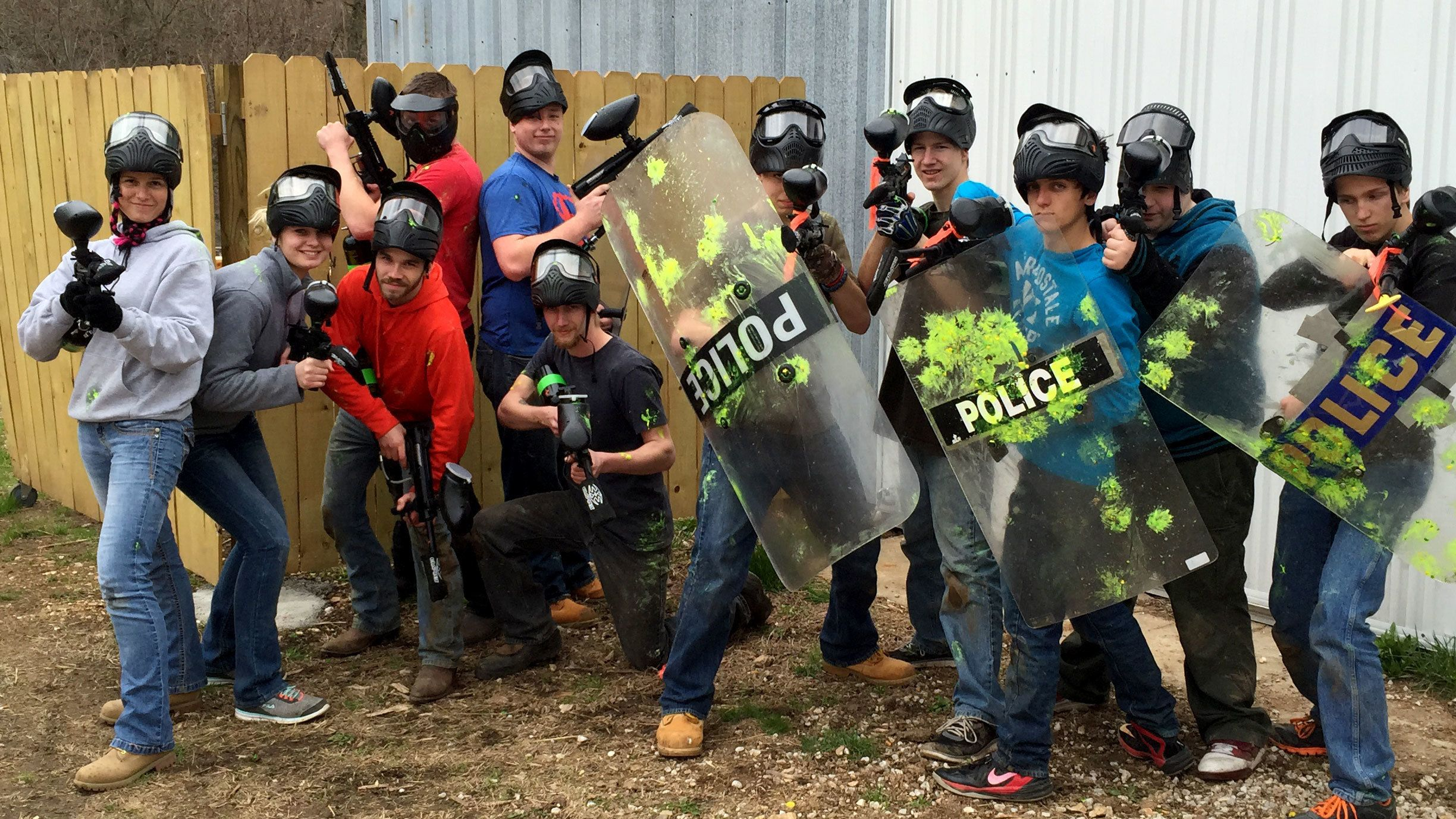 Group of paintballers with guns and shields on a playfield in St Louis