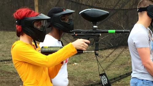 Woman aiming a paintball gun in St Louis