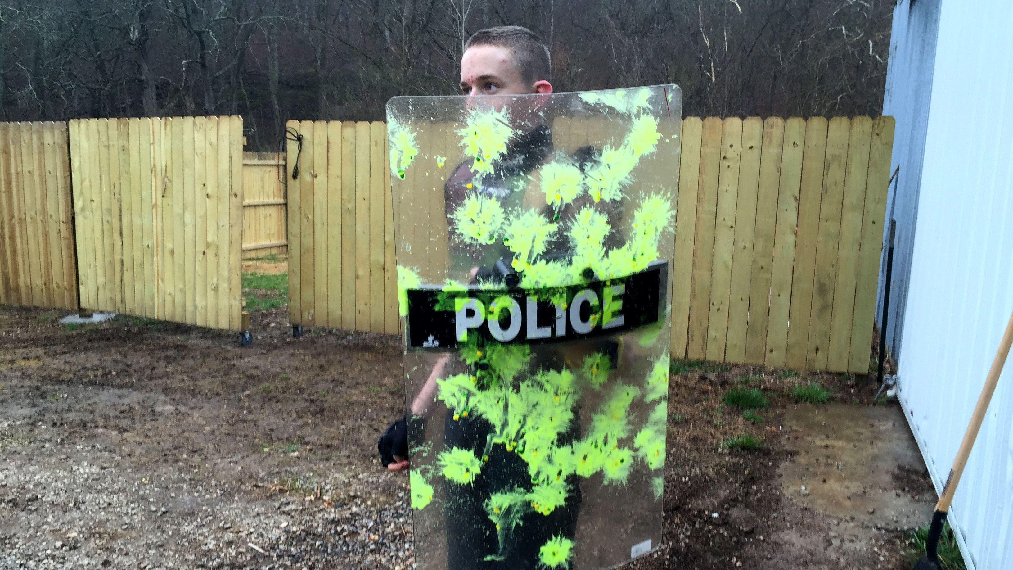 Paintballer holding a splattered shield in St Louis