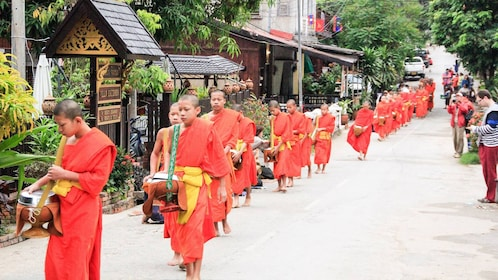 A procession of Buddhist Monks in robes